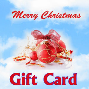 Blue Sky in background, the words Merry Christmas in cursive above a collection of ribbons, ornaments and tinsel in the middle and Gift card written along the bottom